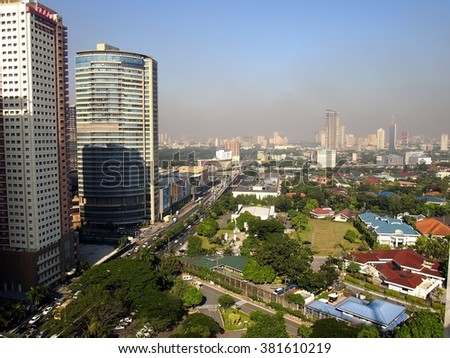 PHILIPPINES - JANUARY 14, 2016: Cityscape and skyline of Pasig City and the neighbor town of Mandaluyong and San Juan City - stock photo