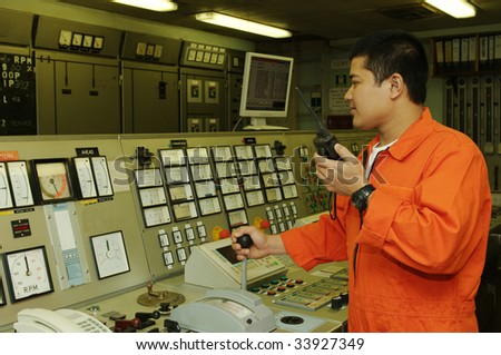 Philippines shipping engineer manages automation panel devices - stock photo