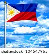 Philippines waving flag against blue sky - stock photo