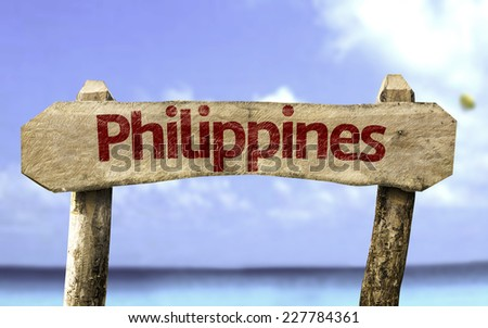 Philippines wooden sign with a beach on background - stock photo