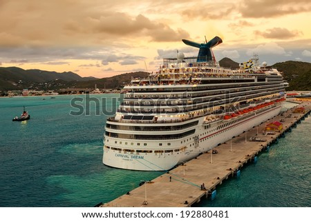 PHILIPSBURG, ST. MAARTEN - JAN. 16, 2013:  Carnival's Dream ship gets ready for departure from at sunset.  The ship is one of Carnival's largest ships, one of three in the line of Dream-classes. - stock photo