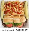 Philly Cheese Steak Sandwich with Fries and Pickles - stock photo