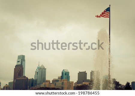 Philly Skyline with Flag and Water Feature. - stock photo