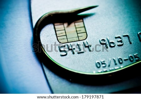 phishing / fish hook in on a credit card / computer threats / financial fraud / cyber crime - stock photo