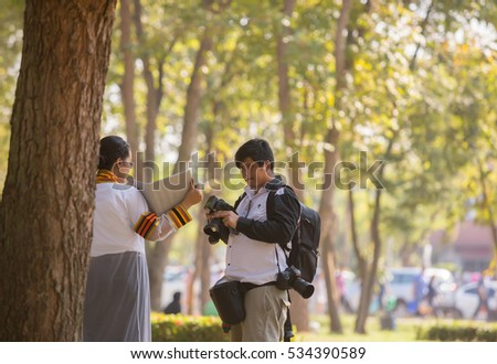 PHITSANULOK, THAILAND - DECEMBER 9 , 2016 : Photographers shooting Graduation in Phitsanulok, Thailand