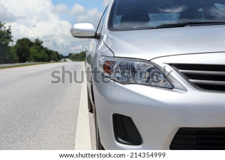PHITSANULOK, THAILAND - SEPTEMBER 1: Front Part of Toyota Altis on the Road, on September 1, 2014.