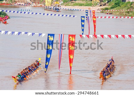 PHITSANULOKE, THAILAND - SEP 21 : Panning technique unidentified crew in traditional Thai long boats competition festival on September 21, 2008, Phitsanuloke, Thailand.  - stock photo