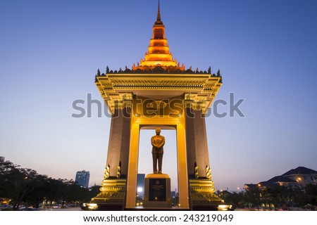 PHNOM PENH - NOV 17: A bronze statue of the late King Father Norodom Sihanouk Statue at sunset on November 17, 2014 in Phnom Penh.   - stock photo