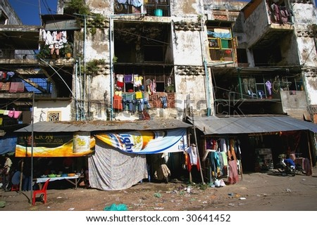 PHNOM PENH - NOVEMBER 18: Rundown area of the capital November 18, 2006 in Phnom Penh. 35 percent of the Cambodian population live below the poverty line, residing in houses of inferior quality.