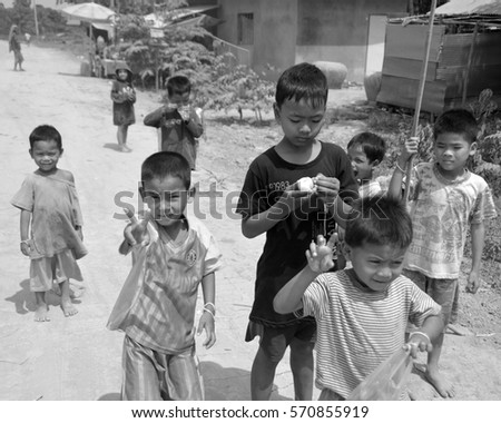 PHNOM PHEN, CAMBODIA MARCH 23: Unidentified street children posing on march 23 2013 in Phnom Phen,Cambodia.In Phnom Penh alone there are between 10,000 and 20,000 children live and work on the streets