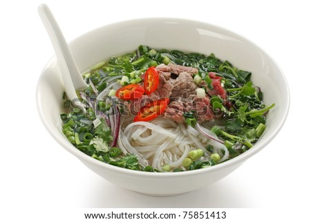 Pho bo , Vietnamese  food , rice noodle soup with sliced rare beef - stock photo