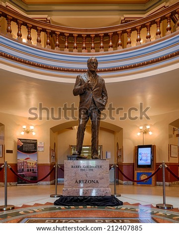 PHOENIX, ARIZONA - AUGUST 6: Barry Goldwater statue behind state seal in the Arizona State Capitol building on August 6, 2014 in Phoenix, Arizona - stock photo
