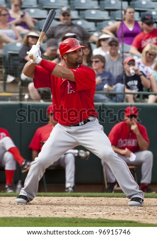PHOENIX, ARIZONA– MARCH 4: Albert Pujols of the Los Angeles Angels of Anaheim takes his first at bat of Spring Training in Phoenix, Arizona on March 4, 2012. - stock photo