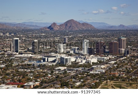 Phoenix, Arizona skyline along Central Avenue with Camelback Mountain in the distance - stock photo
