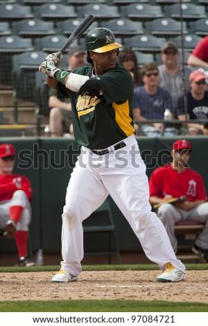 PHOENIX, ARIZONA, USA – MARCH 4: Manny Ramirez of the Oakland Athletics bats during a Spring Training game in Phoenix Arizona on March 4 2012. - stock photo