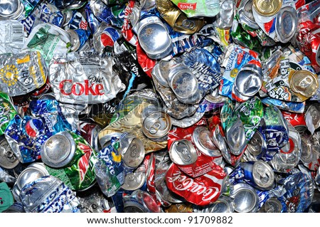 PHOENIX, AZ - APRIL 29: Crushed soda and beer cans at a recycling facility in Phoenix AZ on April 29, 2009. The cans will be shipped to an aluminum foundry. - stock photo