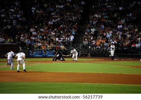 PHOENIX, AZ - AUGUST 11 - Diamondbacks pitcher Livan Hernandez lays down a sacrifice bunt in a game against the Marlins August 11, 2006 in Phoenix, AZ. - stock photo