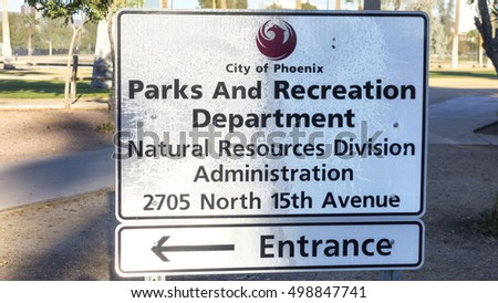 PHOENIX, AZ - DECEMBER 25, 2013: City of Phoenix Parks and Recreation Department sign in Encanto Park that points to a building of Natural Resources Division Administration entrance.