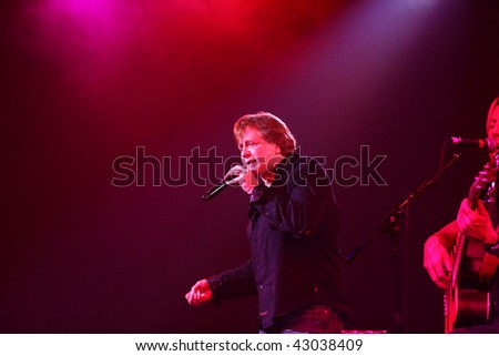 PHOENIX, AZ-DECEMBER 17: Legendary classic rocker Eddie Money performs an acoustic set of his chart-topping hits for fans at the Celebrity Theatre on December 17, 2009 in Phoenix AZ. - stock photo