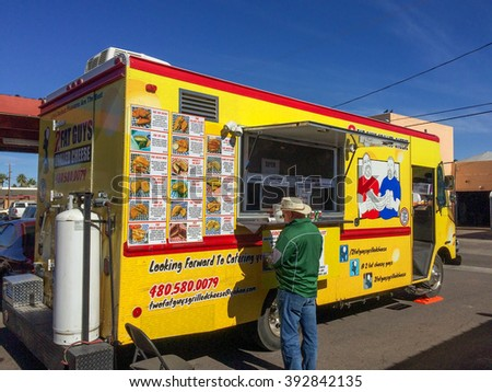 PHOENIX, AZ - FEBRUARY 5, 2016: A man buying lunch from Two Fat Guys Grilled Cheese food truck at designated outdoor spot in downtown of Phoenix, AZ - stock photo
