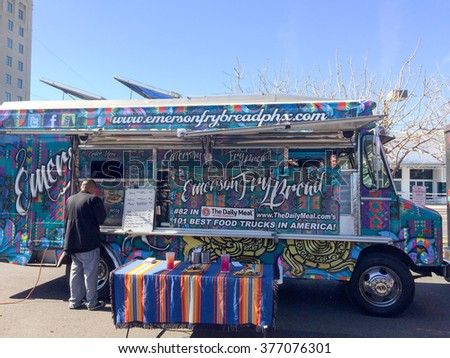 PHOENIX, AZ - FEBRUARY 5, 2016: Emerson Fry Bread food truck with colorful paint job servicing a customer in designated lunch area of Phoenix downtown, Arizona - stock photo