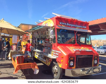 PHOENIX, AZ - FEBRUARY 5, 2016: Lunch goes buying and waiting for meal from Burgers Amore food truck at designated outdoor spot in downtown of Phoenix, AZ - stock photo