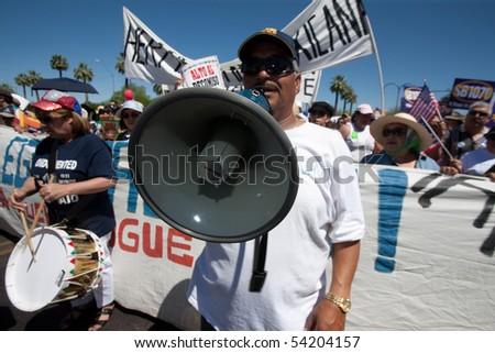 PHOENIX, AZ - MAY 29: Man with bullhorn at Arizona anti-SB1070 rally.  May 29, 2010 in Phoenix, AZ. - stock photo