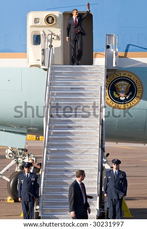 PHOENIX, AZ - MAY 13: President Barack Obama disembarks from Air Force One at Phoenix Sky Harbor Airport on May 13, 2009 in Phoenix, AZ. - stock photo