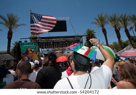 PHOENIX, AZ - MAY 29: Protestors near state capitol at Arizona anti SB1070 rally.  May 29, 2010 in Phoenix, AZ. - stock photo