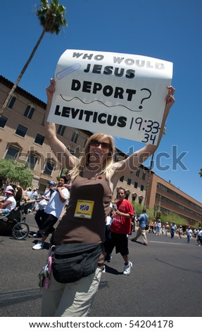 PHOENIX, AZ - MAY 29: Woman with sign citing Leviticus at SB1070 protest rally.  May 29, 2010 in Phoenix, AZ. - stock photo