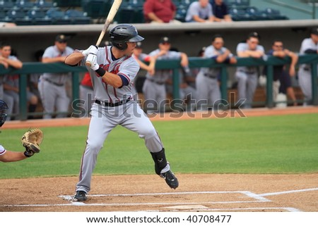 PHOENIX, AZ - NOVEMBER 4: Brandon Hicks, a top prospect at shortstop in the Atlanta Braves' farm system, bats in an Arizona Fall League game Nov. 4, 2009 at Phoenix Municipal Stadium, Arizona. - stock photo