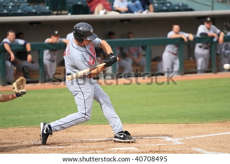 PHOENIX, AZ - NOVEMBER 4: Matt McBride, future star for the Cleveland Indians, swings away in an Arizona Fall League game Nov. 4, 2009 in Phoenix, Arizona. McBride's Peoria Saguaros won, 3-2. - stock photo