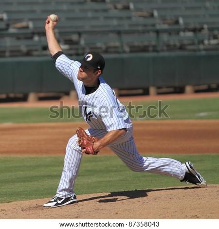 PHOENIX, AZ - OCTOBER 19: David Phelps, a New York Yankees prospect, pitches for the Phoenix Desert Dogs in the Arizona Fall League on Oct. 19, 2011 at Phoenix Municipal Stadium, Phoenix, AZ. Phelps allowed 3 runs. - stock photo