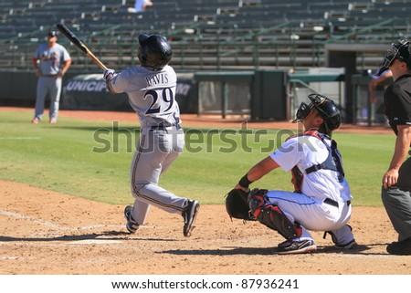 PHOENIX, AZ - OCTOBER 19: Kentrail Davis, a High-A Milwaukee Brewers prospect, bats for the Peoria Javelinas in an Arizona Fall League game Oct. 19, 2011 at Phoenix Municipal Stadium, Phoenix, AZ. - stock photo