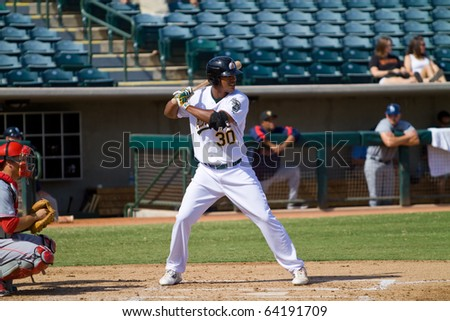 PHOENIX, AZ - OCTOBER 19: Michael Taylor, a top prospect for the Oakland A's, plays for the Phoenix Desert Dogs in an Arizona Fall League game Oct. 19, 2010 at Phoenix Municipal Stadium. - stock photo