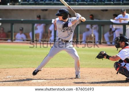 PHOENIX, AZ - OCTOBER 19: Milwaukee Brewers prospect Scooter Gennett bats for the Peoria Javelinas in the Arizona Fall League Oct. 19, 2011 at Phoenix Municipal Stadium in Phoenix, AZ. Gennett had 3 hits and 2 runs. - stock photo