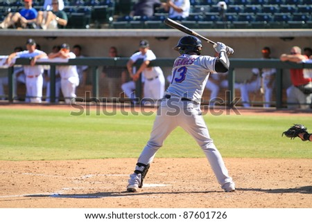 PHOENIX, AZ - OCTOBER 19: New York Mets prospect Juan Lagares bats for the Peoria Javelinas in the Arizona Fall League Oct. 19, 2011 at Phoenix Municipal Stadium in Phoenix, AZ. Lagares, an outfielder, went 1-for-5. - stock photo