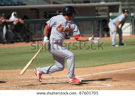 PHOENIX, AZ - OCTOBER 19: St. Louis Cardinals prospect Oscar Taveras bats for the Peoria Javelinas in the Arizona Fall League Oct. 19, 2011 at Phoenix Municipal Stadium in Phoenix, AZ. Taveras doubled twice. - stock photo