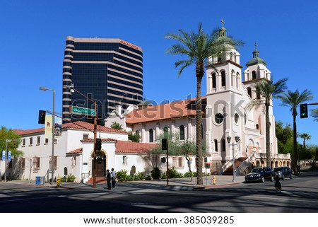 PHOENIX, AZ, USA - FEB 21, 2016:  St. Mary's Church, the oldest Catholic parish in Phoenix, with shopping center and office complex Arizona Center Tower One in the background. - stock photo