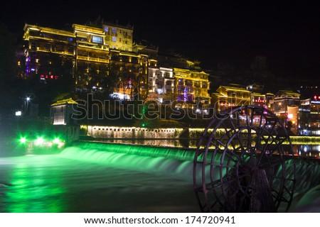 Phoenix County, April 15: Tuojiang River both banks night scenery on April 15, 2012, Phoenix County, Hunan Province, China  - stock photo