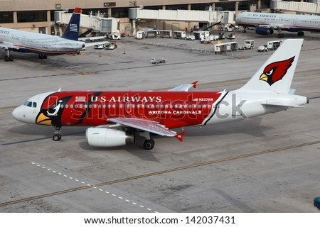 PHOENIX - MARCH 20: A US Airways Airbus A320 Arizona Cardinals logojet taxis on March 20, 2013 in  Phoenix. US Airways is a major US airline, headquartered in Tempe and 51 million passengers in 2009. - stock photo