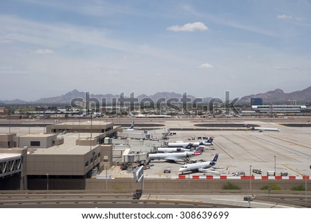 PHOENIX, US - MAY 23, 2015: American Airlines and USAirways airplanes in Phoenix Sky Harbor Airport, Arizona - stock photo