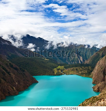 Phoksundo Lake in Dolpo, Nepal. Phoksundo Lake is an alpine fresh water oligotrophic lake in Shey Phoksundo National Park, located in the Dolpa District. - stock photo