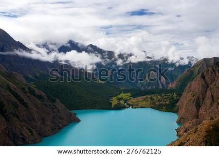 Phoksundo Lake view in the Nepal Himalaya. Phoksundo Lake is an alpine fresh water oligotrophic lake in Shey Phoksundo National Park, located in the Dolpa District. - stock photo