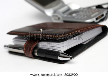 phone and agenda - stock photo