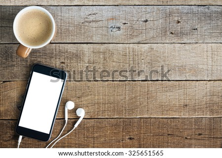 phone and coffee on wood blank space - stock photo
