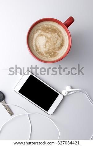 phone and coffee on wooden table, from above - stock photo