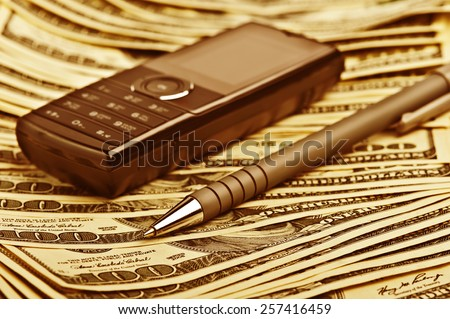 phone and pan on the money background - stock photo