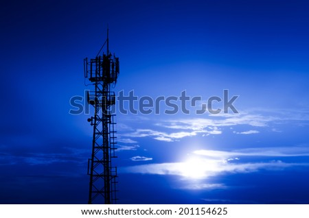 Phone antenna at evening sky , Phone antenna at sunset - stock photo