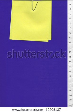 Phone book - A to Z - with a Yellow Sticy note - stock photo
